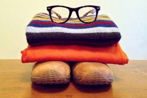 Clothing Pile Wearing Glasses